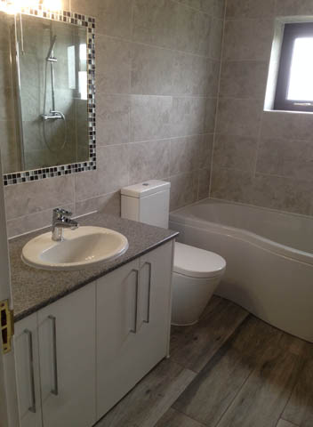 Fully fitted bathroom with shower bath