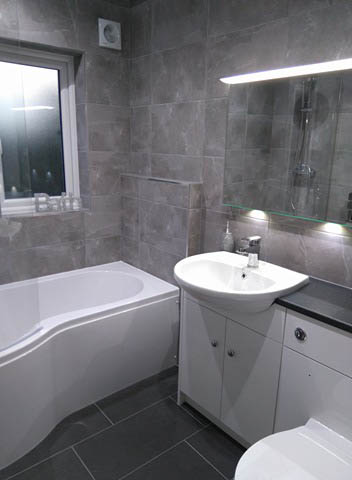 P shaped shower bath with fitted furniture
